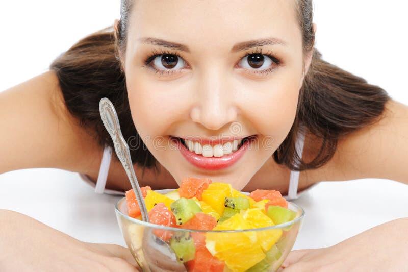 Fêmea feliz com frutas imagens de stock royalty free