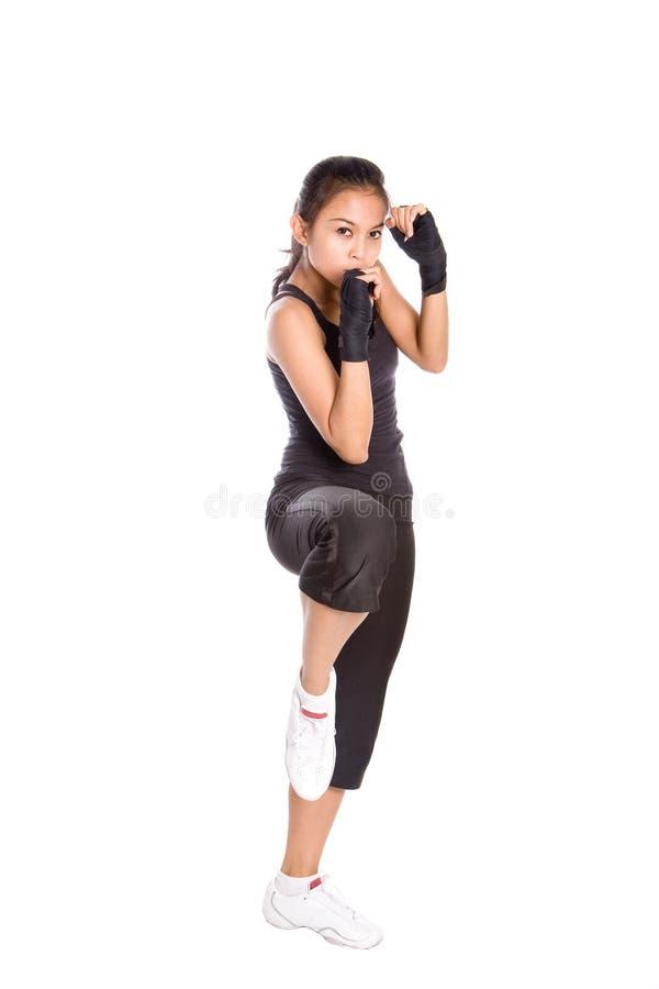 Fêmea no exercício de combate fotografia de stock