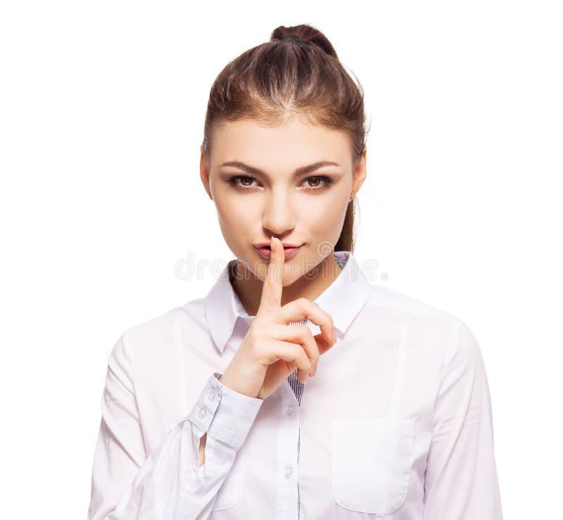 Fêmea nova com seu dedo aos bordos unidos fotografia de stock royalty free