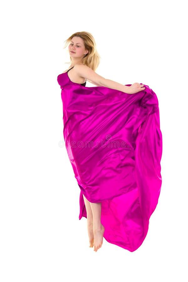 Fêmea nova salto cor-de-rosa vestido da tela imagens de stock