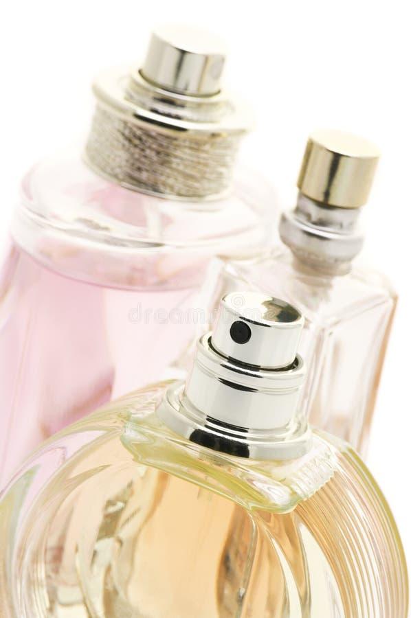 A fêmea perfuma o close-up imagens de stock royalty free