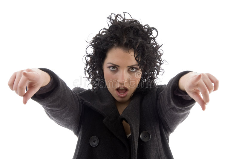 Fêmea que aponta com ambas as mãos imagens de stock royalty free