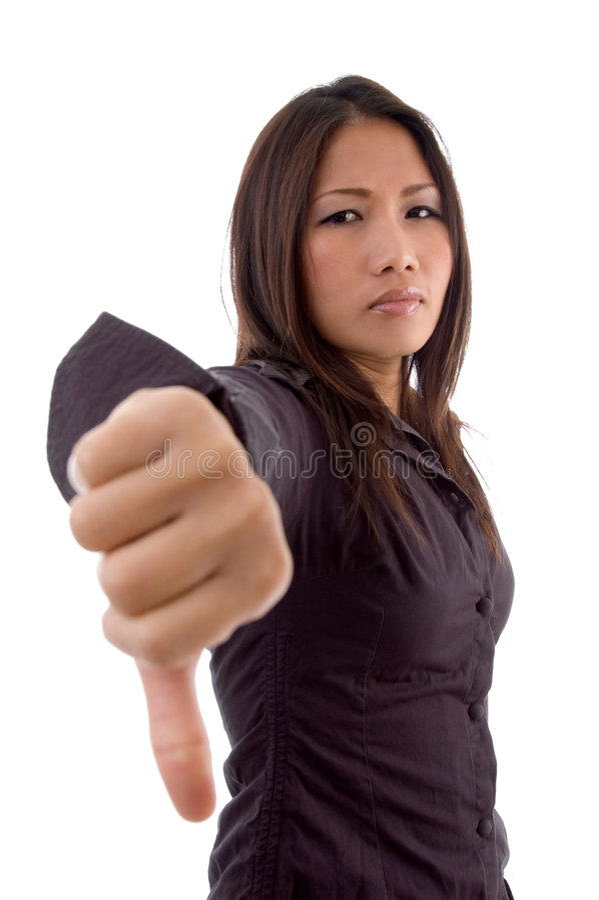 A fêmea que mostra os polegares assina para baixo foto de stock royalty free