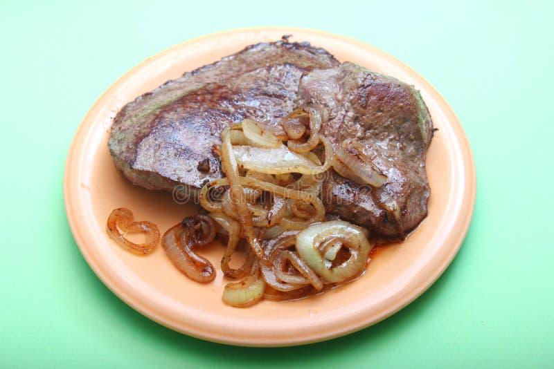 Fígado fresco com cebolas fotografia de stock