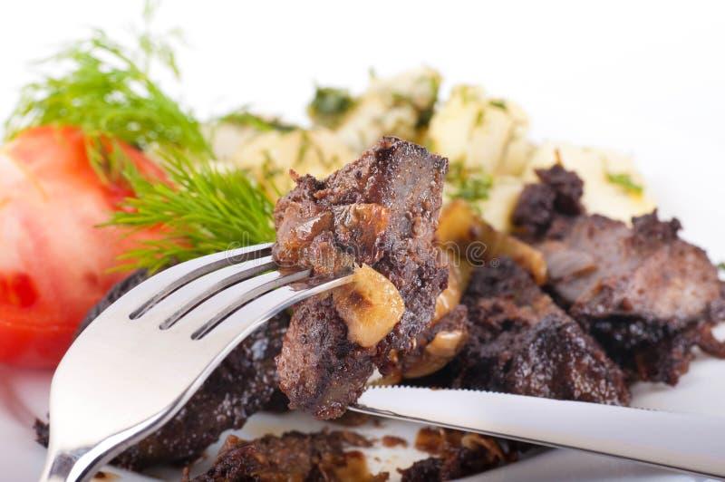 Fígado fritado da carne de porco imagem de stock