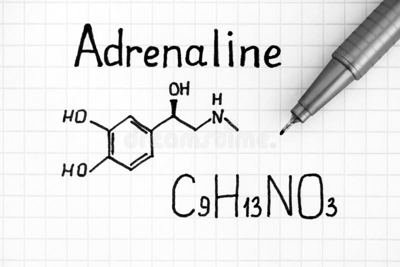 Fórmula química da adrenalina com pena imagens de stock royalty free