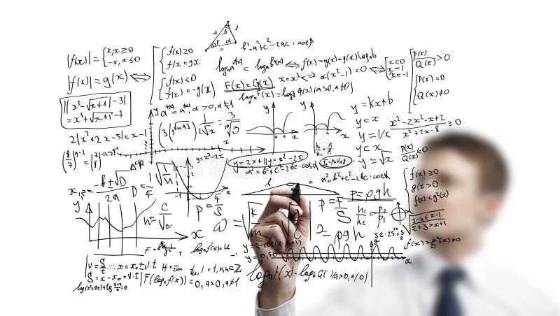 Fórmulas del gráfico del hombre de negocios foto de archivo