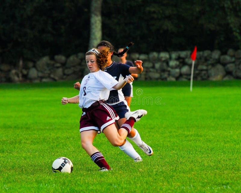 Fósforo de futebol da High School das meninas imagens de stock royalty free