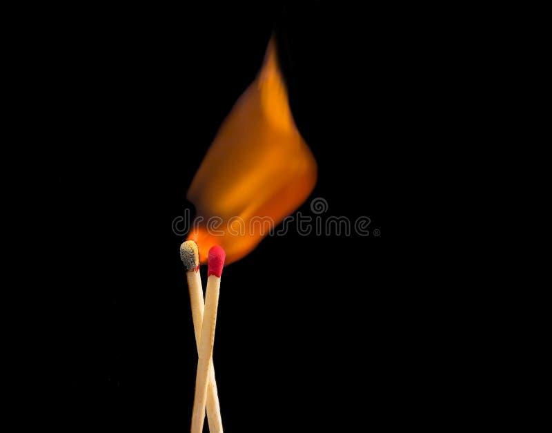Fósforos no incêndio fotografia de stock royalty free