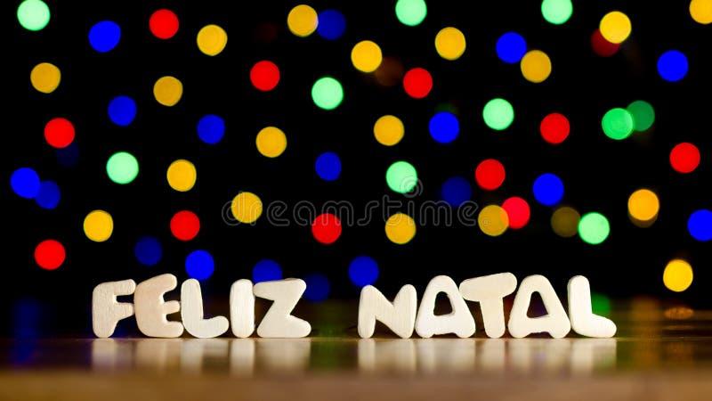 Födelse- Feliz, glad jul i portugisiskt språk royaltyfri foto