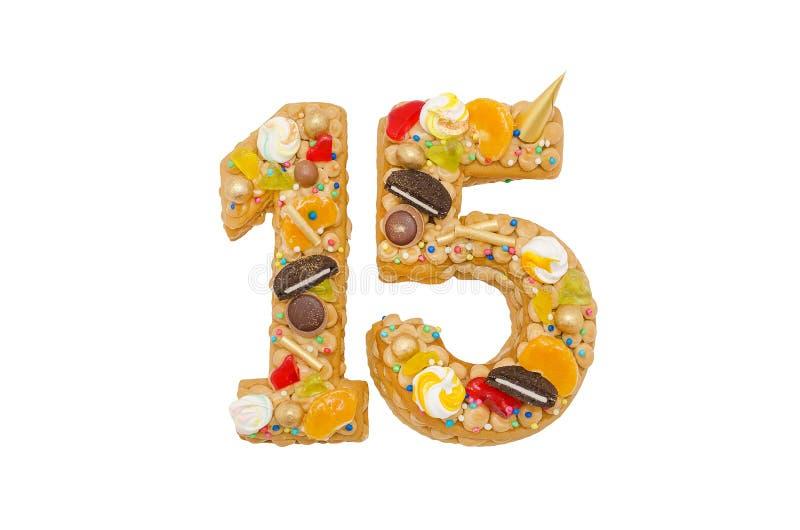 Födelsedagkaka 15 med olika godisar som isoleras på vit fotografering för bildbyråer
