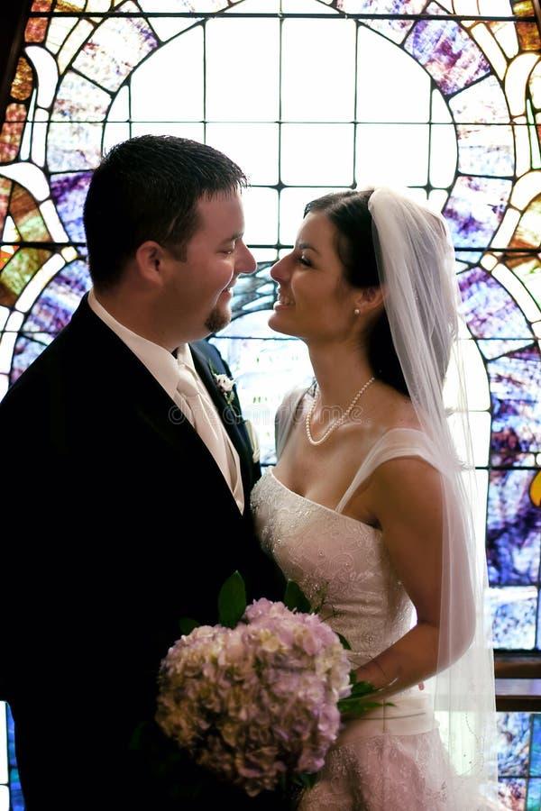 fönster för bröllop för parexponeringsglas nedfläckadt arkivfoto