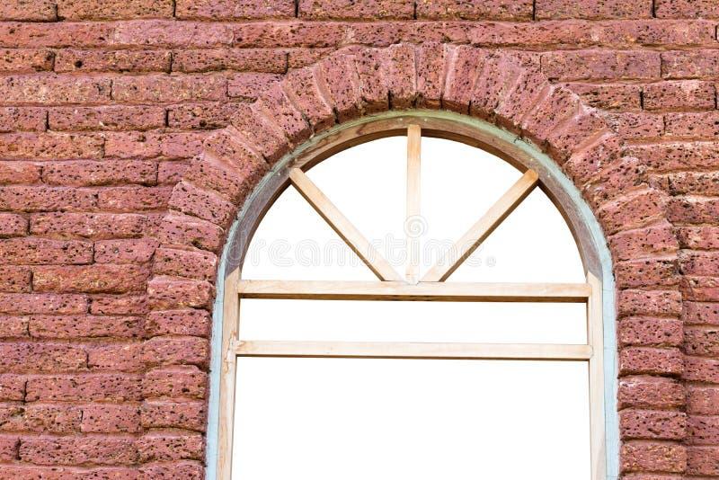 Fönsterram med tegelstenväggen royaltyfri foto