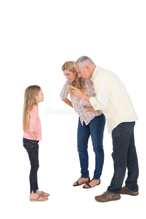 Föräldrar som berättar av deras djärva dotter arkivbilder