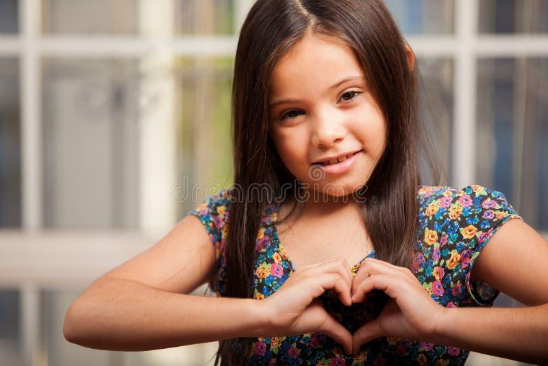Förälskad lycklig liten flicka royaltyfri foto