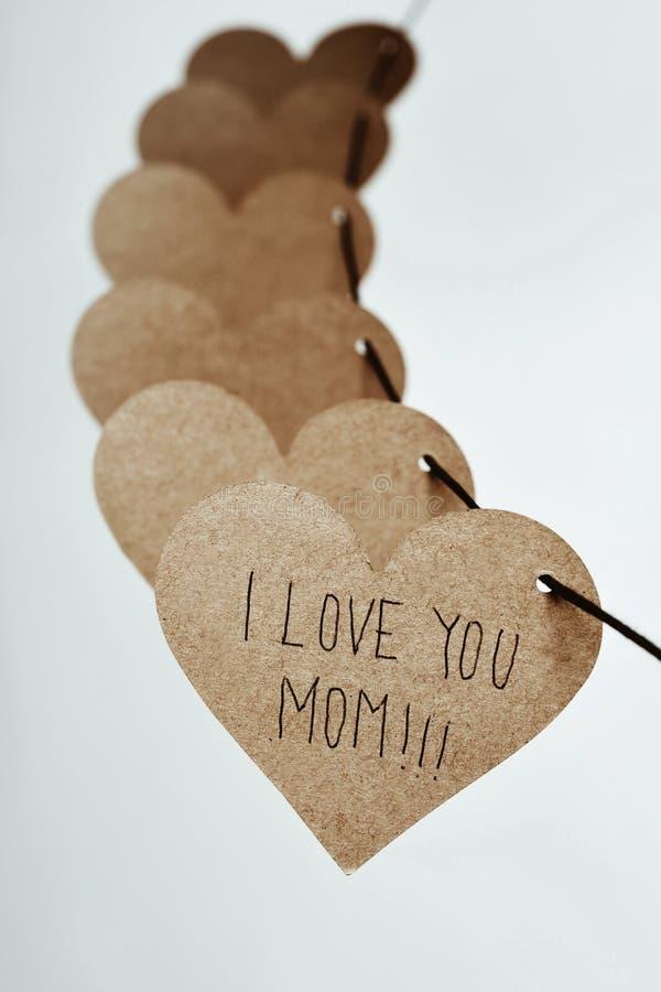 Förälskelse för text I dig mamma i en hjärta arkivbild