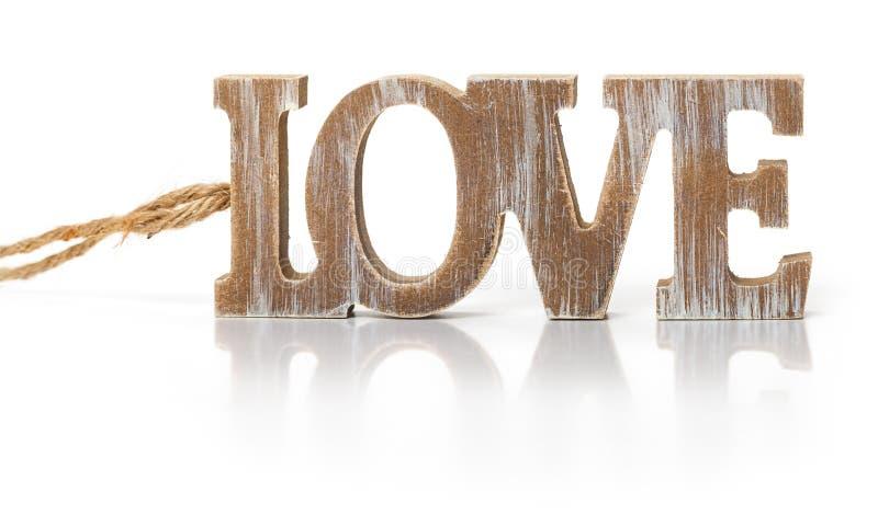 Förälskelse träalfabetbokstäver arkivfoton