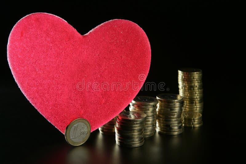 förälskelsemetaforpengar arkivfoton
