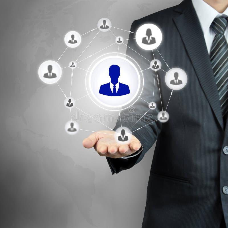 För affärsmansymbol för hand bärande nätverk - timme, MLM & lagarbetsbegrepp arkivfoton
