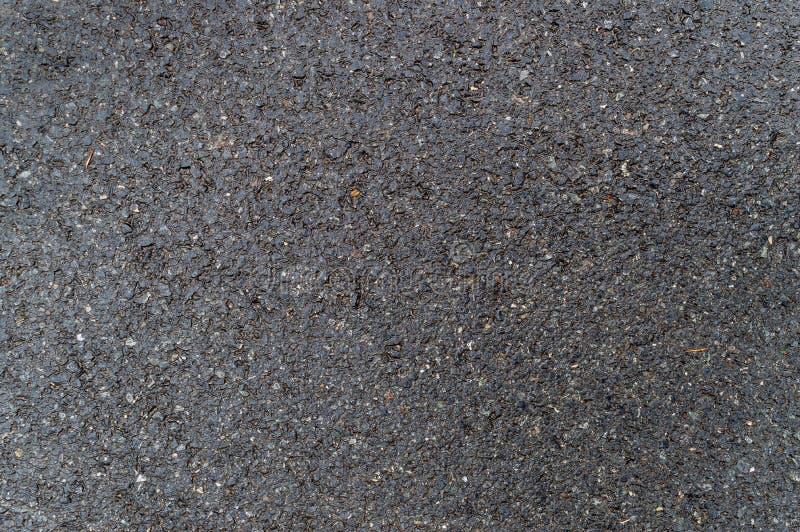 För asfalttextur för mörker våt grov bakgrund arkivbild