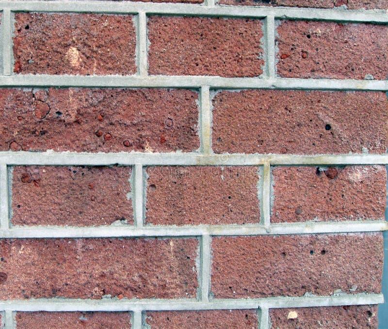 för brunt röd stads- vägg byggnadscement för tegelsten arkivbild