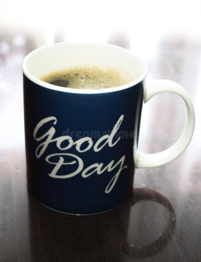 För en bra dag behöver vi ett bra kaffe royaltyfria foton