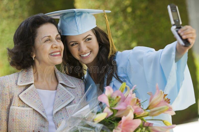 för farmorbild för cell doktorand- ta royaltyfria foton