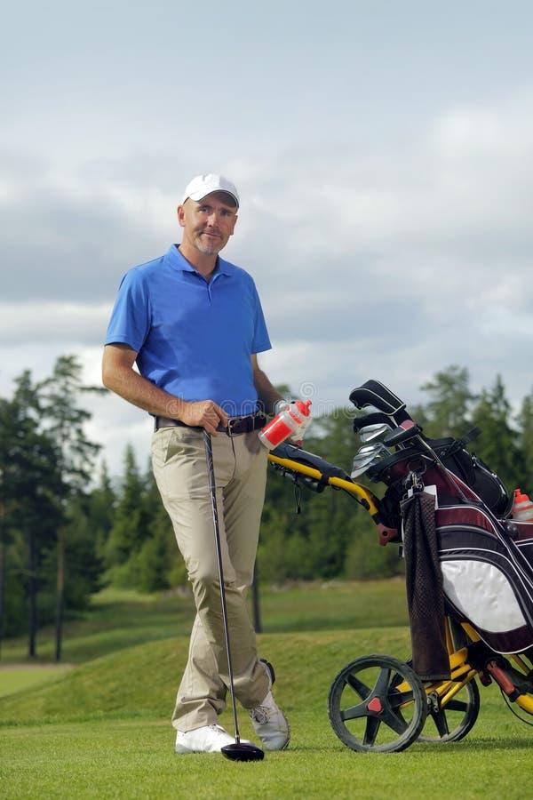 för full plattform sticks golfman för påse arkivbild