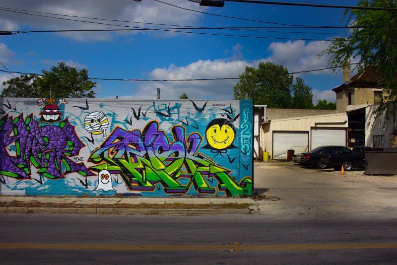 för grafittigata för konst färgrik räknad vägg arkivfoto