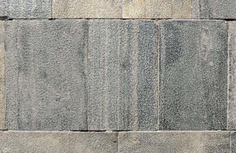 För granitterrass för smutsig yttersida gamla tegelplattor arkivbild