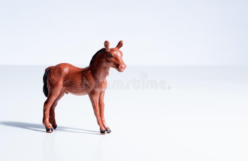 För hästleksak för tappning plast- diagram royaltyfria foton
