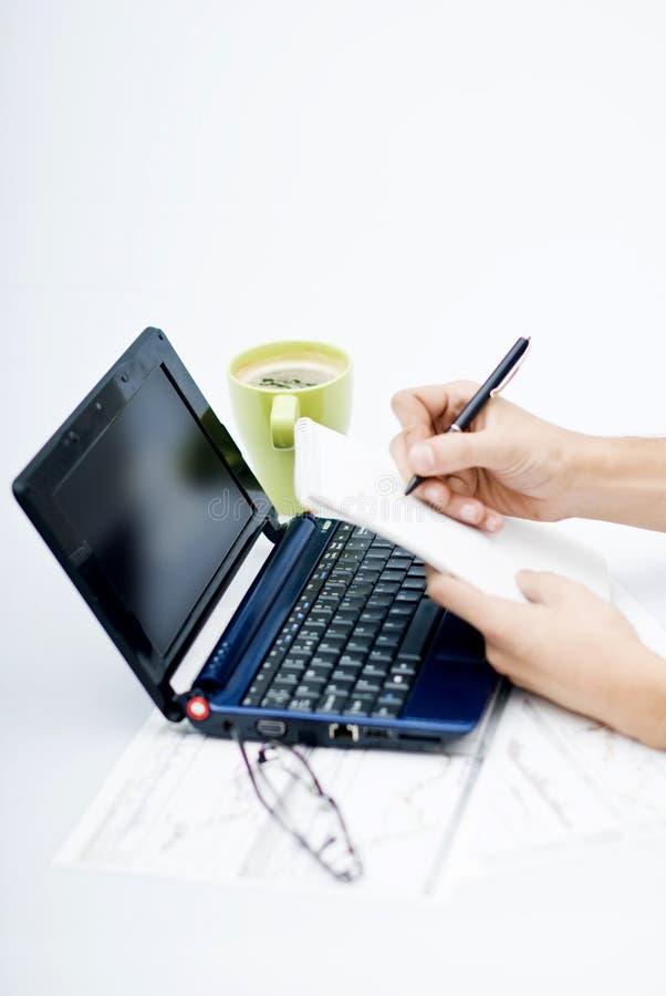 för handbärbar dator för dagordning främre writing arkivfoto