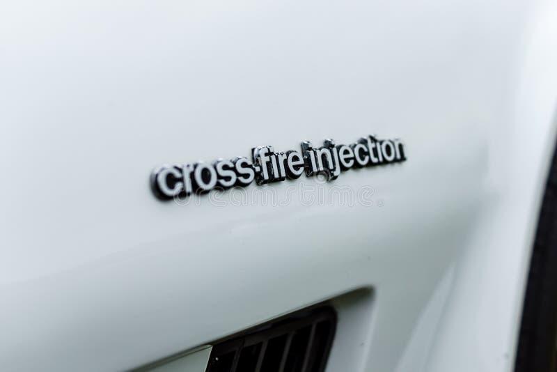 ` För injektion för inskrift`-Crossfire på kroppen av sportbilen Chevrolet Corvette C3, 1982 arkivfoto
