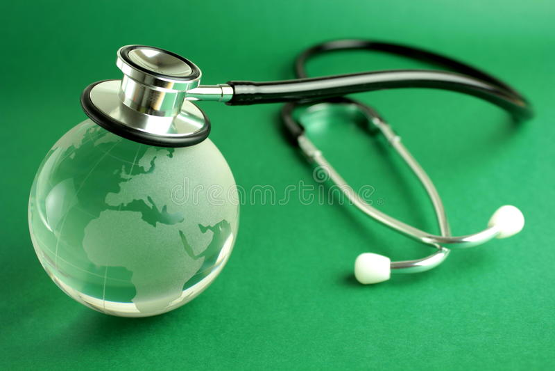 för jordklotgreen för bakgrund crystal stetoskop royaltyfria bilder
