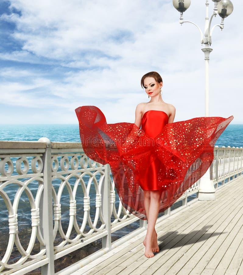 för klänning rött sexigt kvinnabarn long arkivfoton