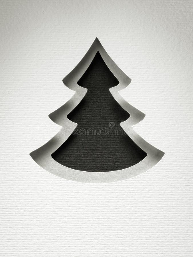 För klippdesign för julgran pappers- kort för monokrom för tappning royaltyfri fotografi