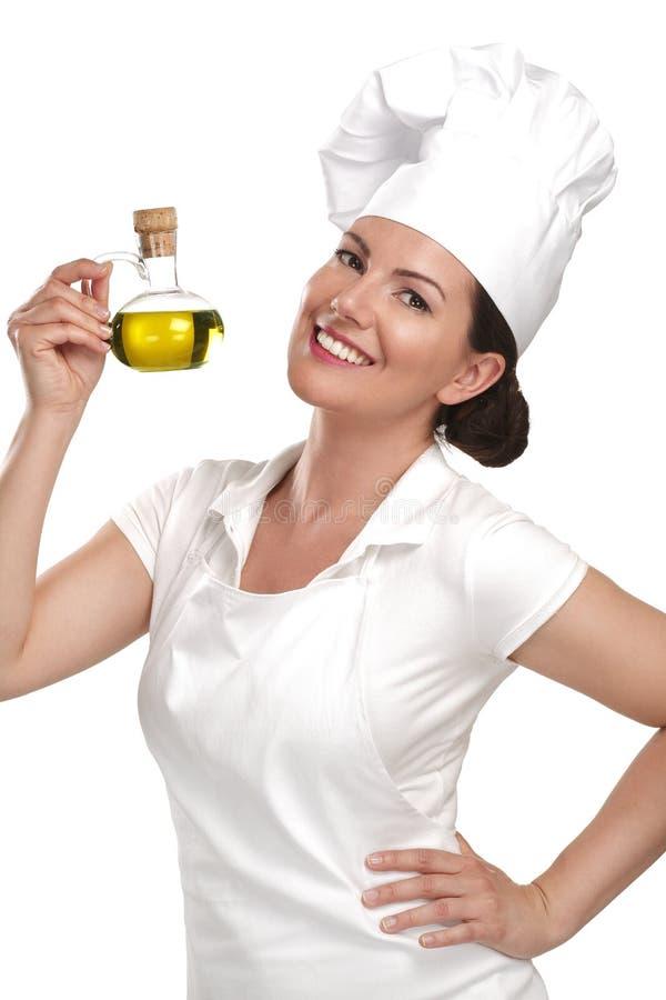 För kockvisning för ung kvinna ingredienser för italiensk mat arkivfoton