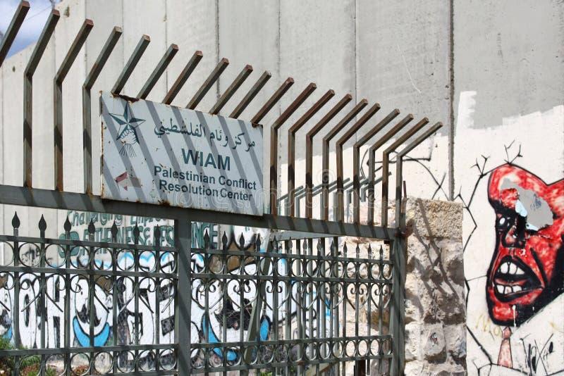 För konfliktupplösning för WIAM palestinskt tecken för mitt, Betlehem royaltyfri fotografi