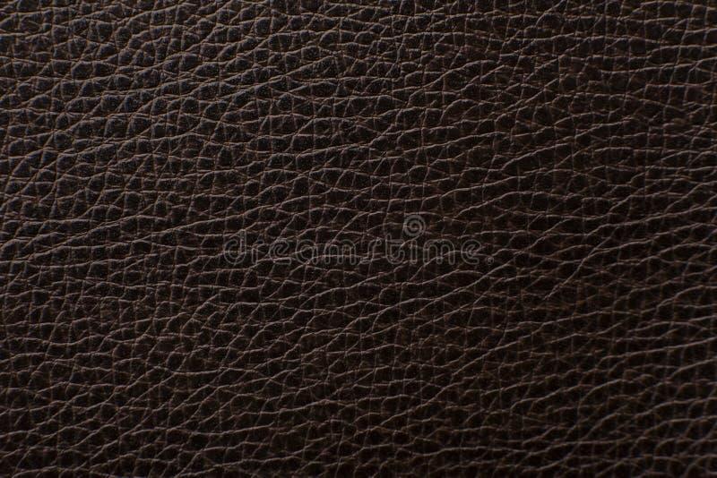 För lädertextur för mörk brunt tryck som bakgrund arkivbilder