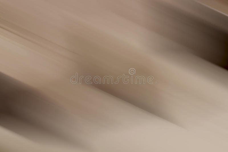 För lutningbakgrund för beiga brun suddighet fotografering för bildbyråer