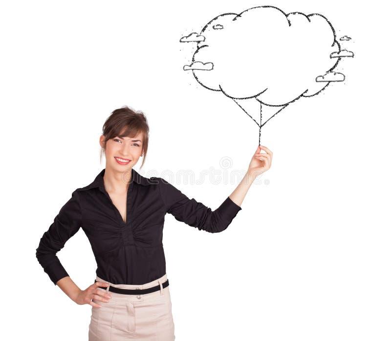 För molnballong för ung lady hållande dra arkivbild