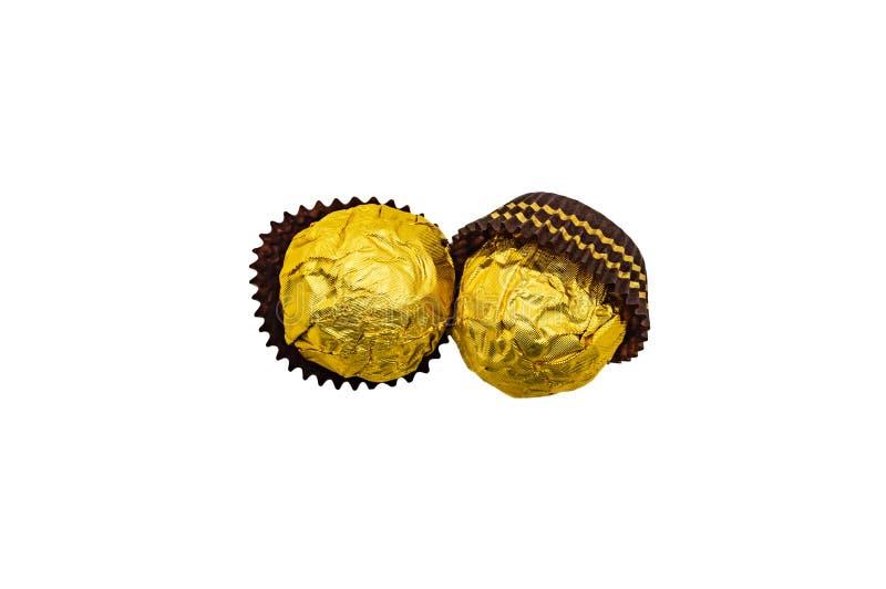 För närbildisolat för godis söt guld- mutter för karamell för kräm arkivbilder
