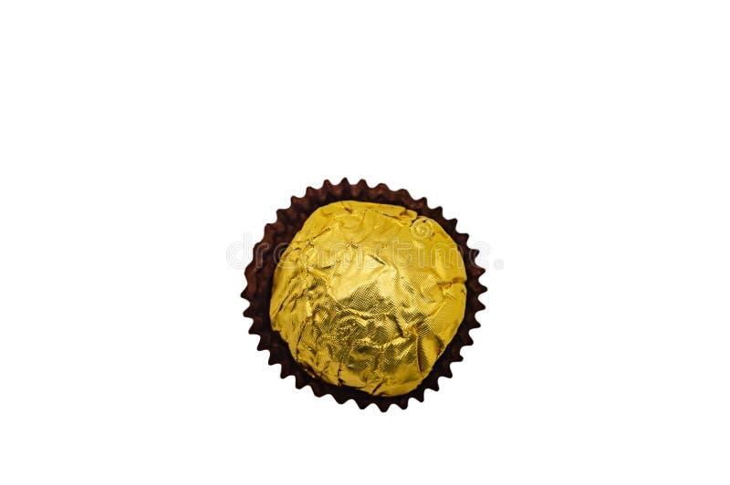 För närbildisolat för godis söt guld- mutter för karamell för kräm royaltyfri fotografi