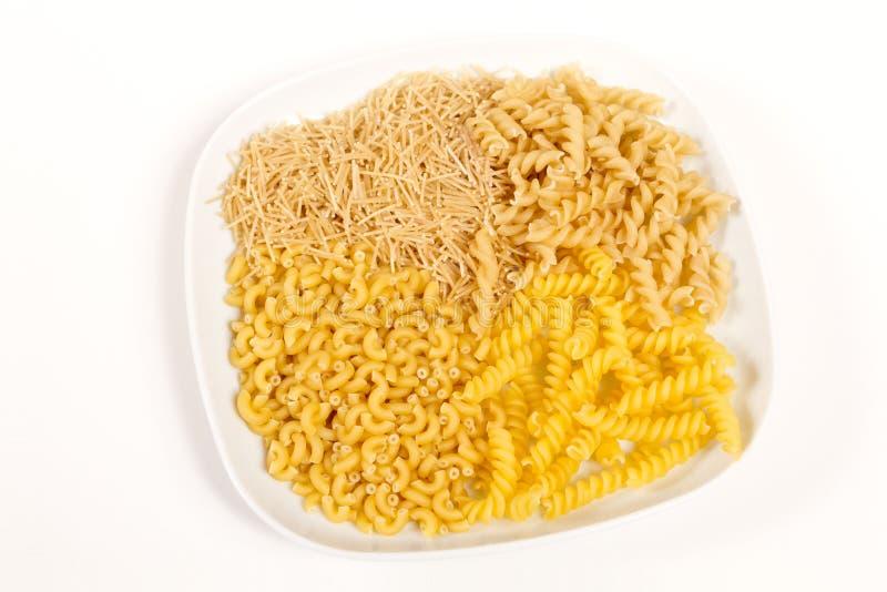för pastaplatta för fyra sorter rundad fyrkant royaltyfria foton