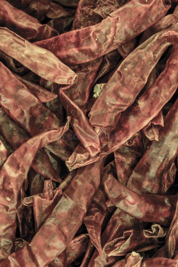 För pepparchili för bakgrund meny för rengöringsduk för substrate för design för torr grund för peppar akut kulinarisk arkivbild