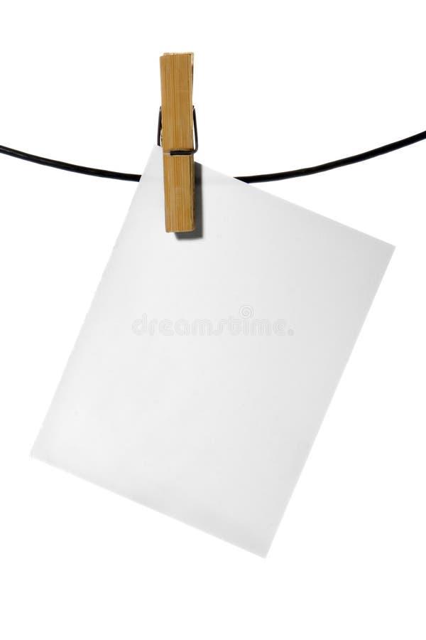för pinnerep för kläder paper white arkivfoto