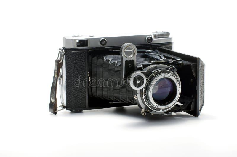 För Rangefinderfilm för tappning som hopfällbar kamera isoleras på vit bakgrund royaltyfri fotografi