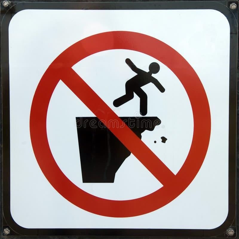 för risktecken för fara fallande varning arkivbild