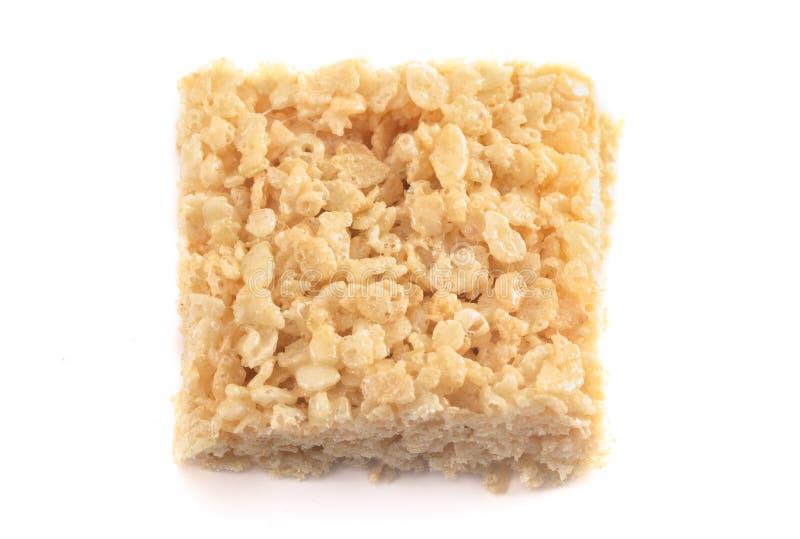 För rissädesslag för marshmallow frasiga stänger för fest på en vit bakgrund arkivfoto