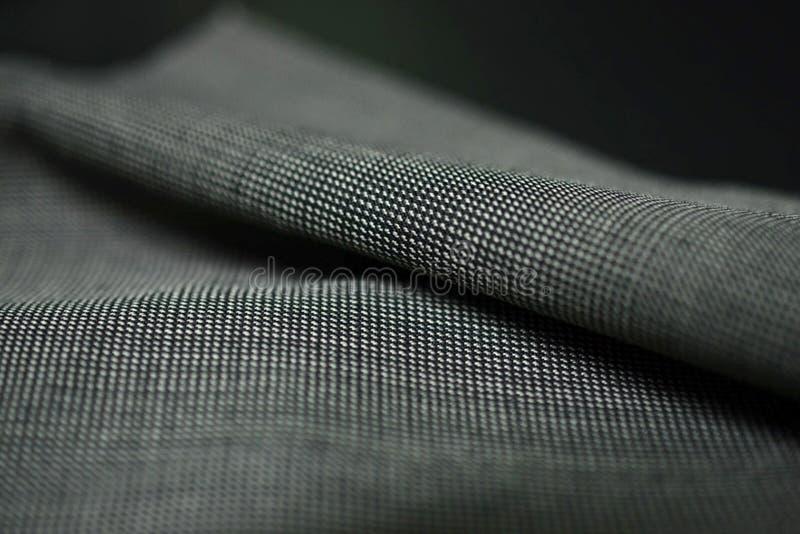 För rullmodell för slut övre tyg för grå färger av dräkten arkivfoto
